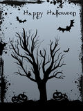 Grunge Halloween background with tree and bats Stock Images