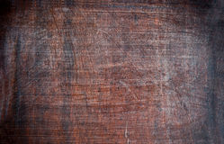 Grunge hardwood oak plank background or texture. Closeup of dirty oak plank royalty free stock photo