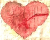 Grunge heart. Old and yellow sheet of paper with red heart Stock Image