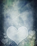 Grunge hearts background. Grunge hearts over blue textured background Stock Photography