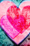 Grunge Hearts Background. Valentine hearts. Red and pink tones on a turquoise rough, grungy background Royalty Free Stock Image