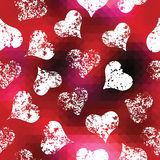Grunge hearts on red pixels background Stock Photography