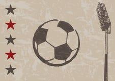 Grunge Hintergrund - Fußball und Scheinwerfer   Lizenzfreie Stockfotografie