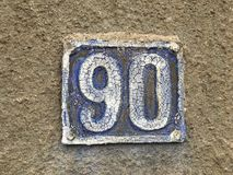 Grunge 90 house plate Royalty Free Stock Image