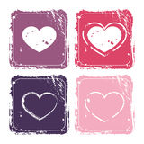 Grunge icons. Four grunge icons with hearts in pink and purple flowers Royalty Free Stock Image