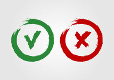 Grunge icons ticked and cross. The green symbol is approved and the red X sign. Two  sketched by rough brush. Round torn buttons for web design. Vector Stock Photography