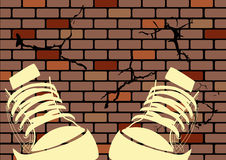 Grunge illustration of a weathered wall. And sneakers Royalty Free Stock Photos