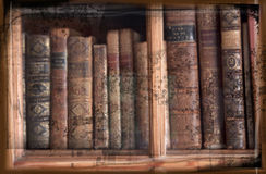 Grunge image of antique books in bookcase. Grunge image of antique books standing on a row in an old glassfronted bookcase Stock Image