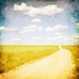 Grunge image of contruside road and blue sky stock images