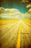 Grunge image of highway and blue sky Royalty Free Stock Image