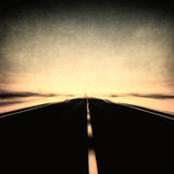 Grunge image of highway and blue sky in motion blur. Grunge vintage image of highway and blue sky in motion blur Royalty Free Stock Images