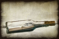 Grunge Image Of Message In A Bottle Stock Photography