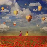 Grunge Image Of Small Girls With Colorful Hot Air Balloons Royalty Free Stock Photography