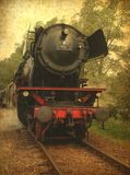 Grunge image of a old steamtrain Stock Photos