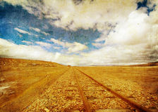 Grunge image of railroad tracks and blue sky Royalty Free Stock Photo