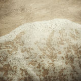 Grunge image of sand and sea foam Royalty Free Stock Photos