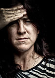 Grunge image of a very stressed woman royalty free stock photography