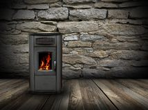 Grunge interior backdrop with burning stove Royalty Free Stock Photos