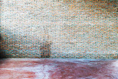 Grunge interior with brick wall Stock Images