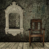 Grunge interior with chair and vintage frame Stock Images