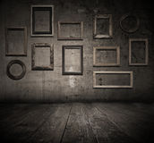 Grunge interior with frames Royalty Free Stock Photos