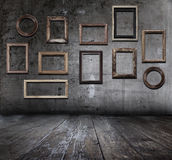 Grunge interior with frames Royalty Free Stock Images