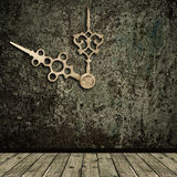 Grunge interior and golden clock hands Royalty Free Stock Images