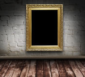 Grunge interior with picture frame Stock Images