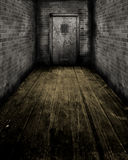 Grunge Interior with a prison door Stock Image
