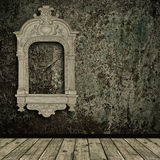 Grunge interior with vintage frame Royalty Free Stock Photography