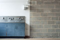 Grunge interior with wall and washing trough Stock Image