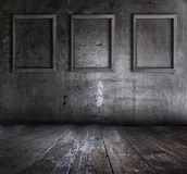 Grunge Interior With Picture Frames Royalty Free Stock Photography