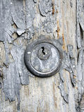 Grunge keyhole. Grunge wooden door detail - keyhole Stock Image