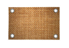 Grunge label of burlap with rivets. Empty grunge label of burlap with rivets Royalty Free Stock Photography