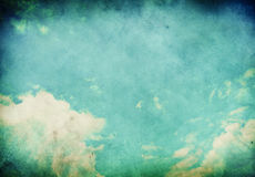 Grunge Landscape with clouds. On old vintage paper Stock Photography