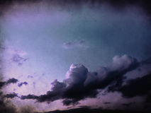 Grunge Landscape with clouds. On old vintage paper Royalty Free Stock Photo