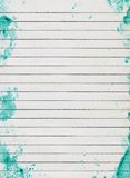 Grunge lined paper. Texture for background, green colour imprint edges Stock Photos