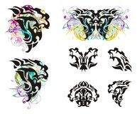 Grunge lion head and lion head symbols. Tribal head of a furious lion in the form of a wing of a butterfly, a butterfly of a lion and lion's symbols isolated on Royalty Free Stock Photography