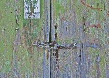 Grunge locked door background Stock Images