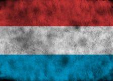 Grunge Luxemburgo señala por medio de una bandera Foto de archivo libre de regalías
