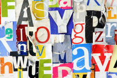 Grunge Magazine Letter Background. A background made up of multicolored cut out magazine letters put together in a collage and photographed in close up. Some Stock Image