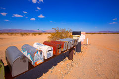Grunge mail boxes in California Mohave desert USA Royalty Free Stock Image