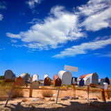 Grunge mail boxes in a row at California Mohave desert Royalty Free Stock Photo