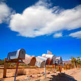 Grunge mail boxes in a row at California Mohave desert Stock Photo