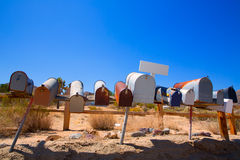 Grunge mail boxes in a row at California Mohave desert Royalty Free Stock Photography