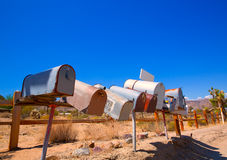 Grunge mail boxes in a row at California Mohave desert Stock Images