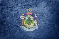 Grunge Maine state flag. Maine flag background grunge texture. Flags of the U.S. state Royalty Free Stock Photography