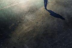 Grunge man walks alone on sandy beach. Man walks alone on grunge textured sandy beach royalty free stock photography