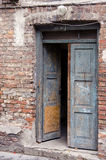 Grunge masonry house doors brick wall background Stock Photo