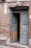 Grunge masonry house doors brick wall background stock photo